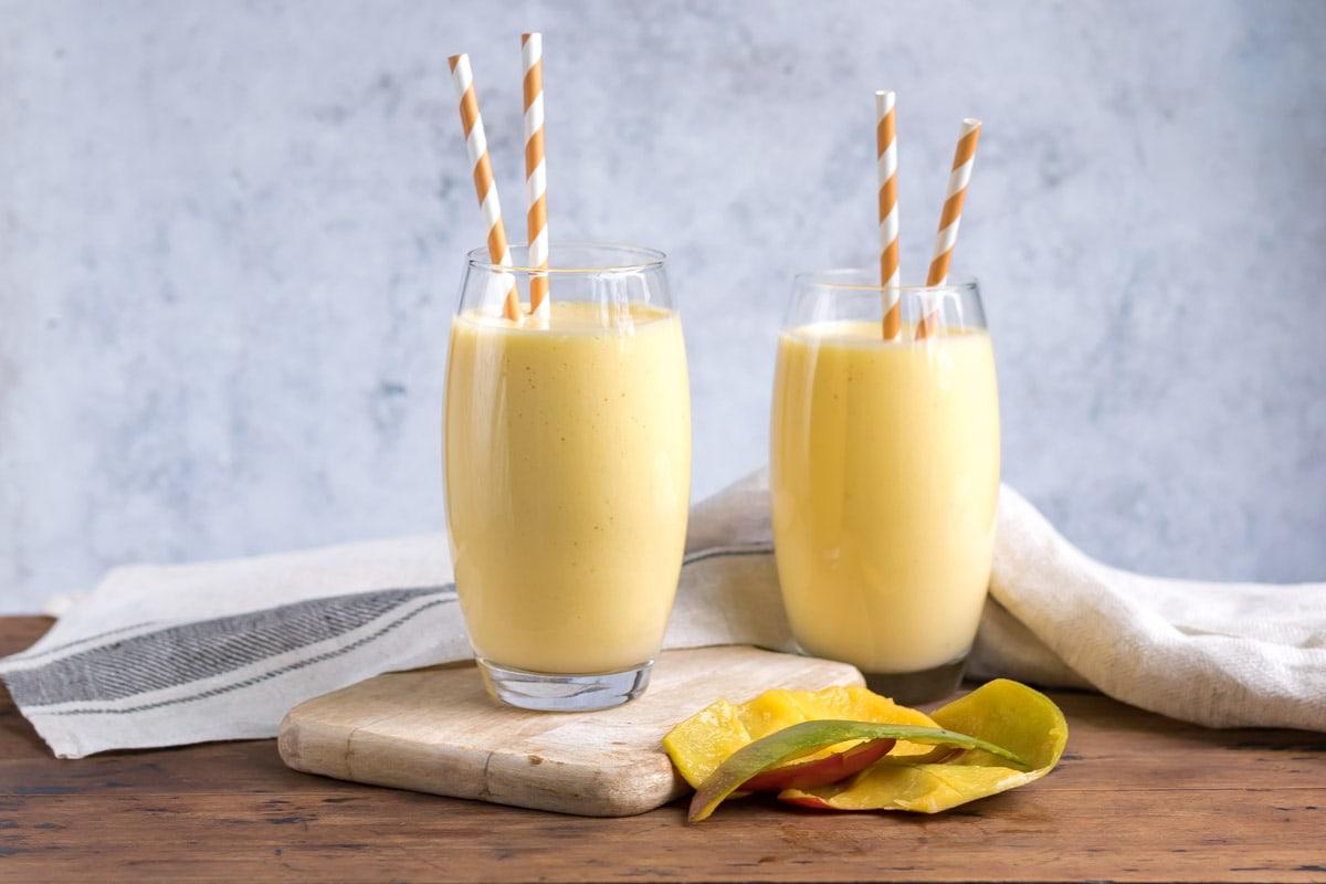 Two glasses of mango milkshake.
