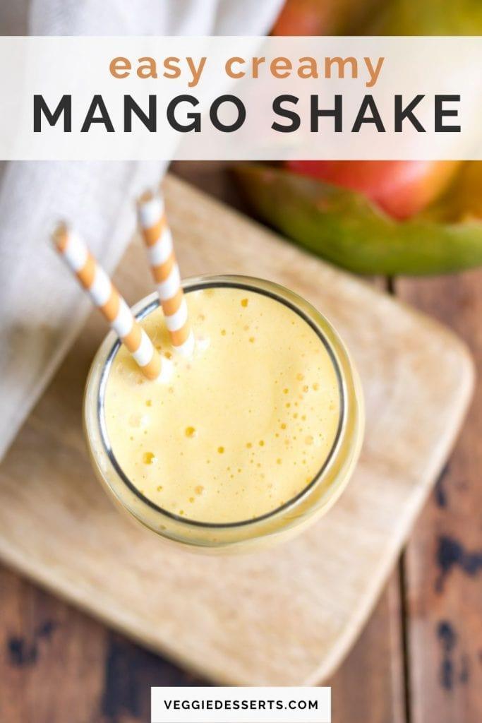 Top of glass of milkshake with text: Easy creamy mango shake.