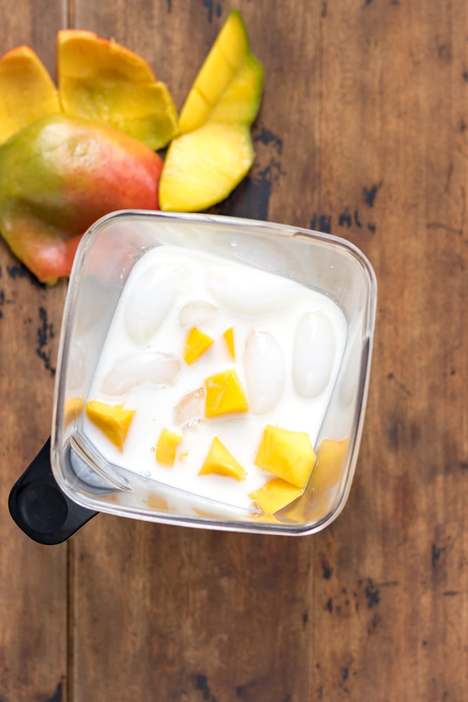 Blender with ice, milk and mango.