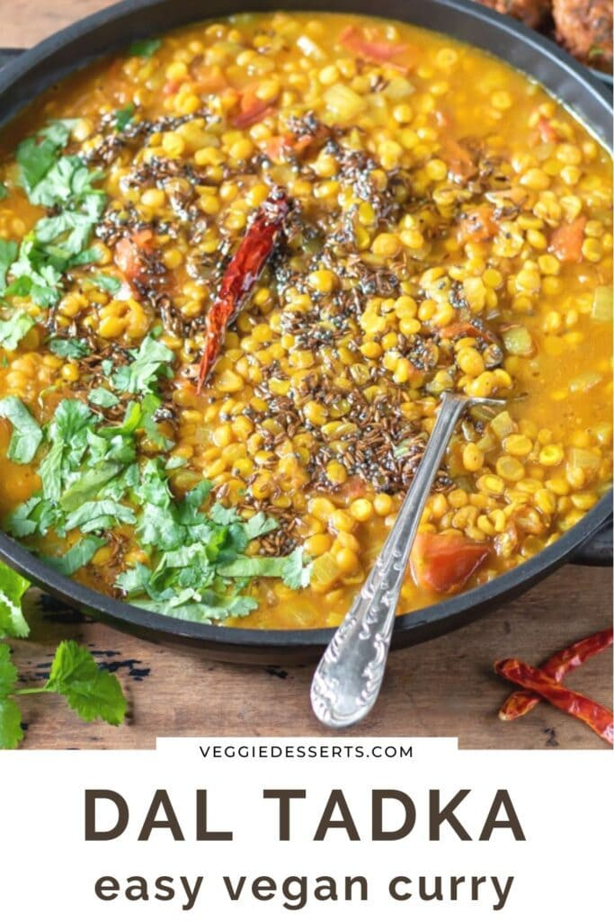 Spoon in dish of curry with text: Dal Tadka, easy vegan curry.