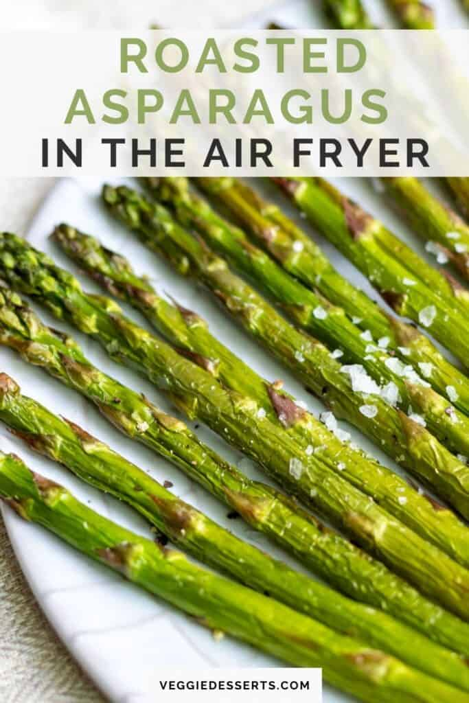 Plate of asparagus with text: Roasted Asparagus in the Air Fryer.