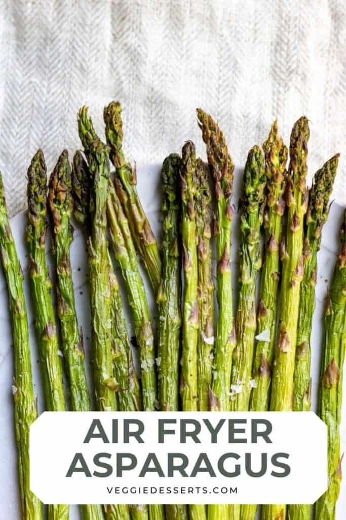 Rows of roasted asparagus with text: Air Fryer Asparagus.