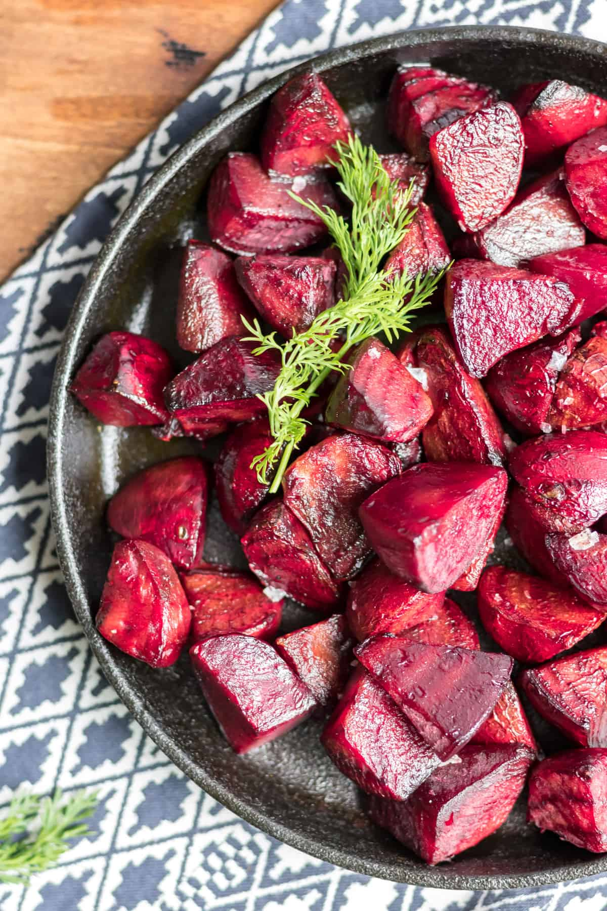 Close up of beetroot chunks on a serving dish.