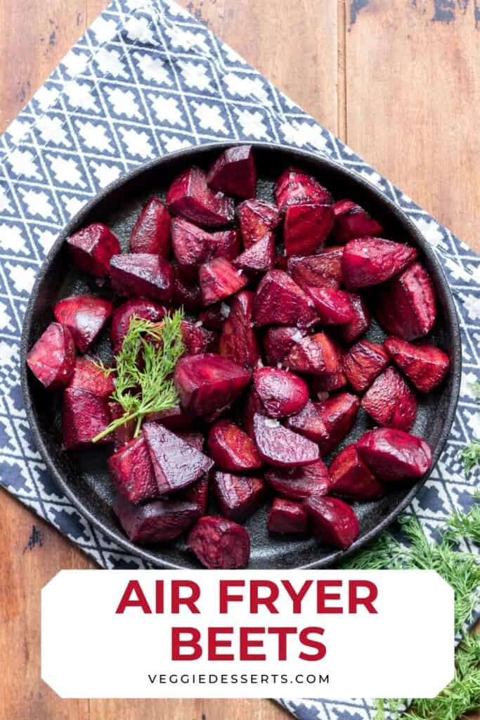 Plate of beets on a table, with text: Air Fryer Beets.