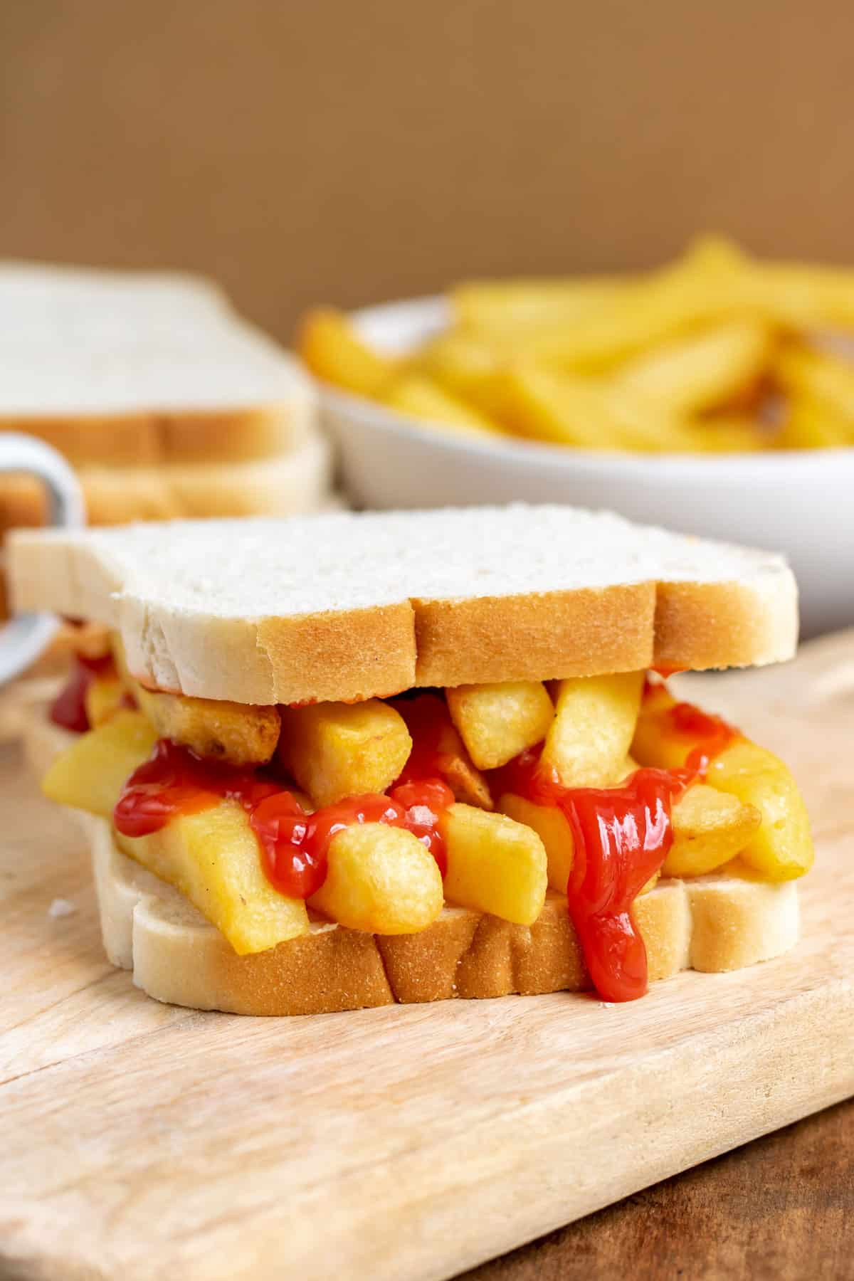 Close up of a french fry sandwich.