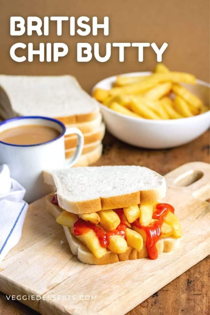Sandwich on a board, with text: British Chip Butty.