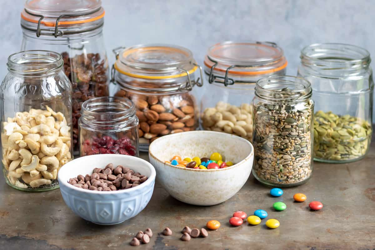Jars of nuts, seeds and dried fruit.