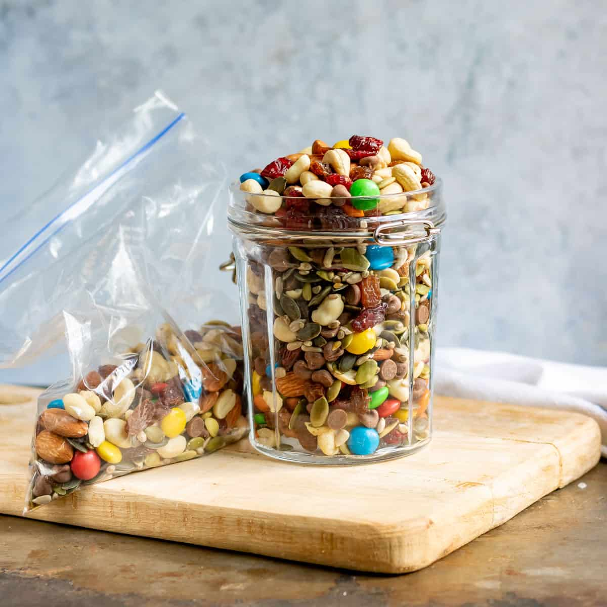 Jar and bag of gorp trail mix.