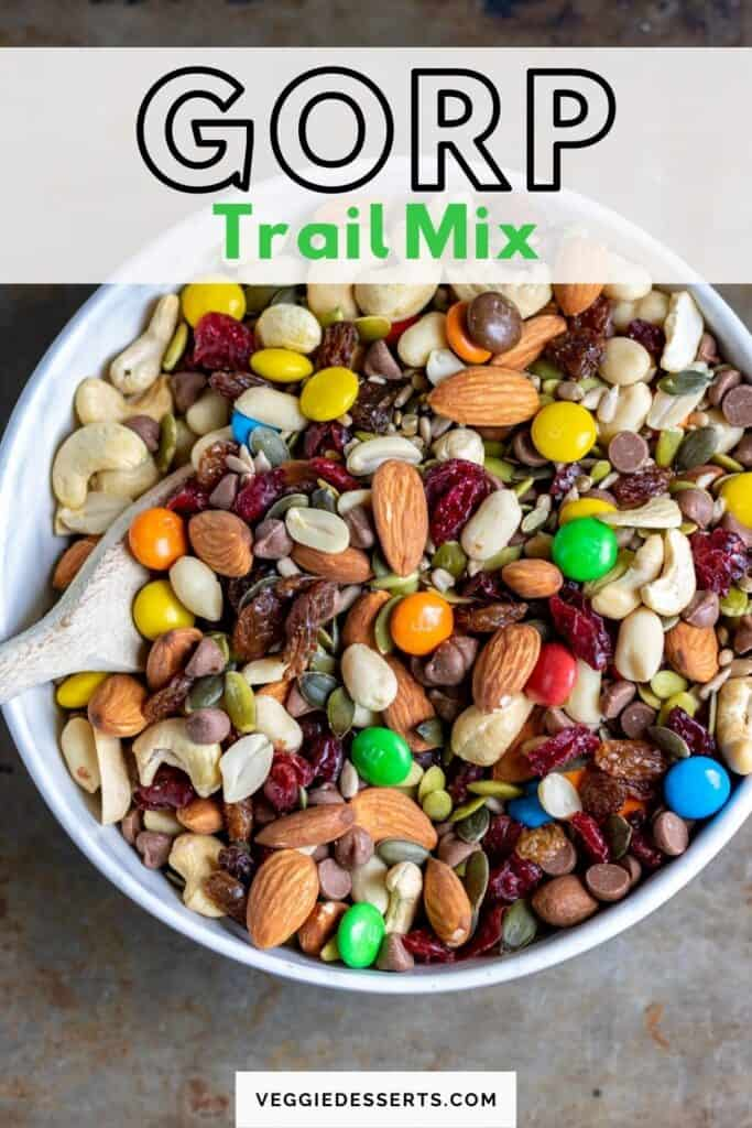 Bowl of nuts and fruit, with text: Gorp Trail Mix.