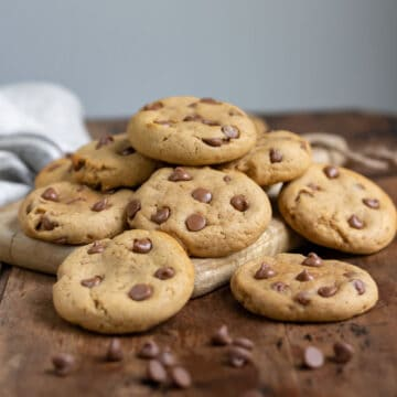 Pile of cookies on a wooden table.