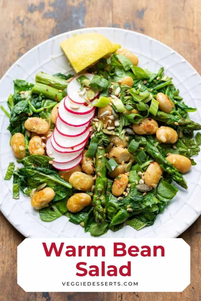 Salad on a plate, with text: warm bean salad.