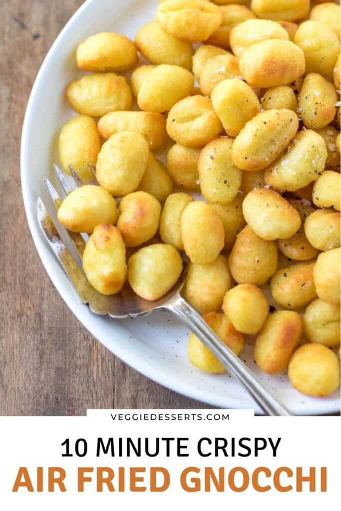 Close up of a dish of gnocchi with text: 10 minute crispy air fried gnocchi.
