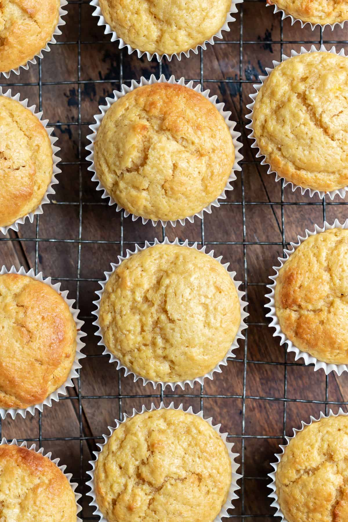 Rows of muffins cooling on a wire rack.