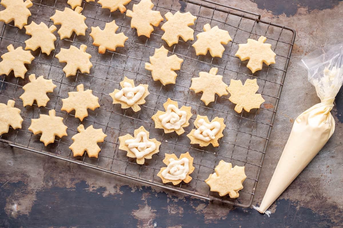 Piping maple cream onto maple cookies.