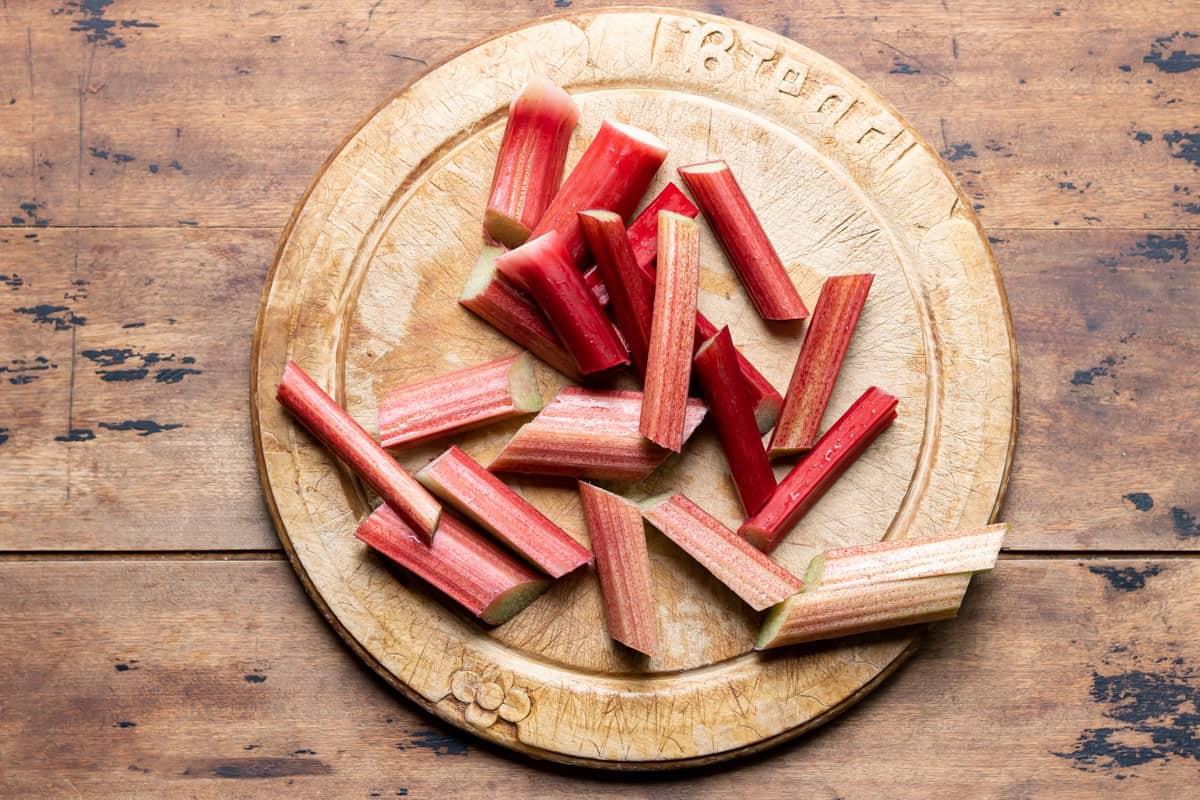 Rhubarb cut on a cutting board.