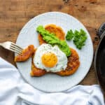 Plate with sweet potato patties topped with a fried egg.