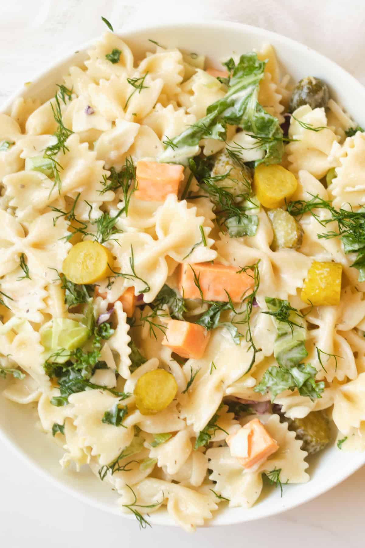 Close up of a bowl of pasta salad.