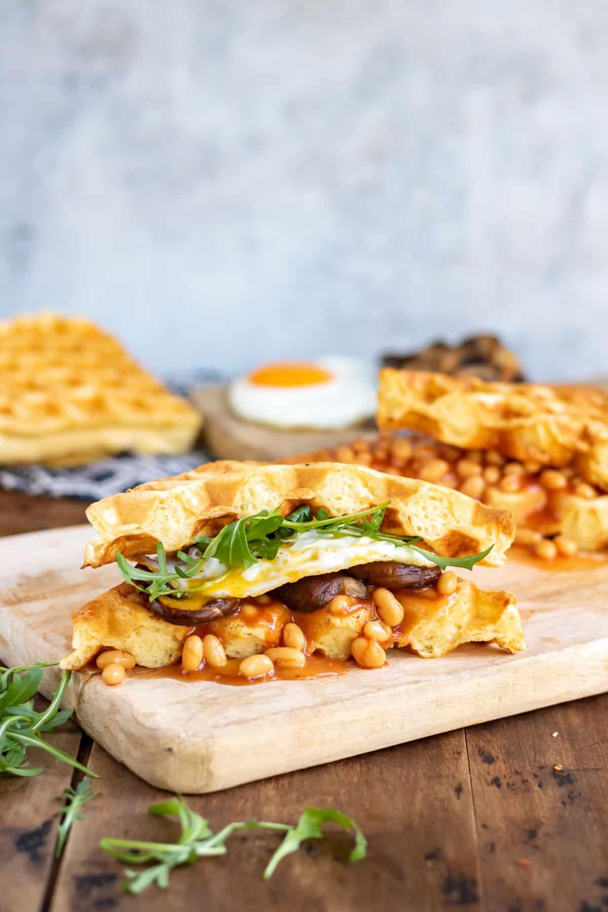 Waffles full of breakfast foods like a sandwich.