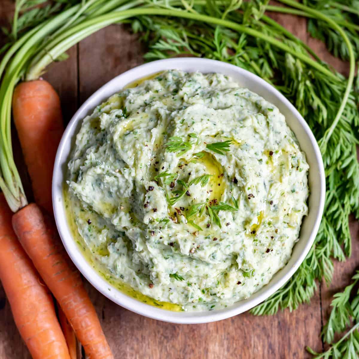 Close up of a bowl of carrot top dip.