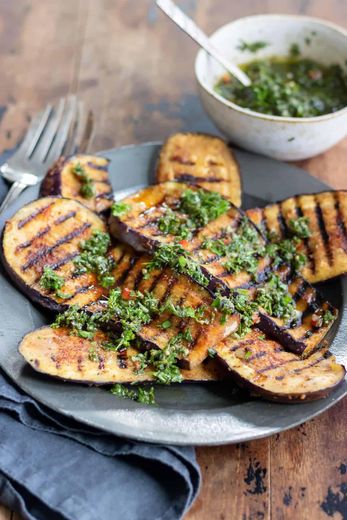 Eggplant steaks with carrot greens chimichurri.