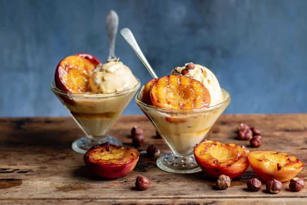 Bowls of ice cream with nectarines.