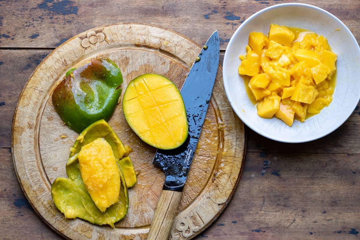 Chopping mango.