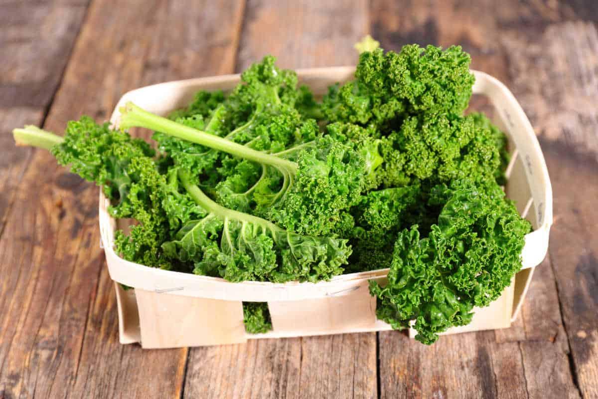 Kale in a wooden basket.