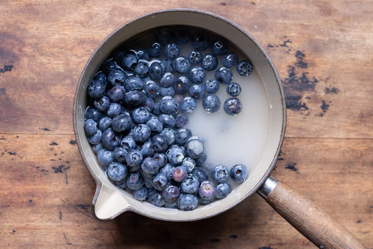 Pot of blueberries, sugar and water.