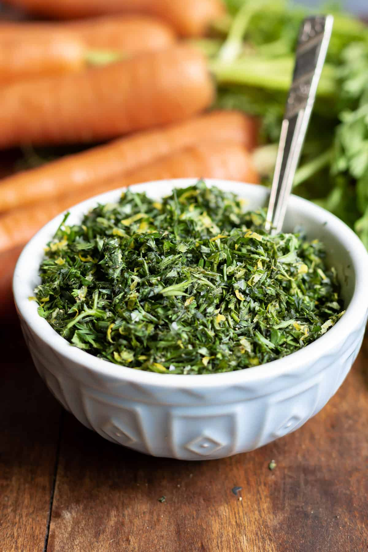 Close up of a bowl of gremolata made with carrot tops.