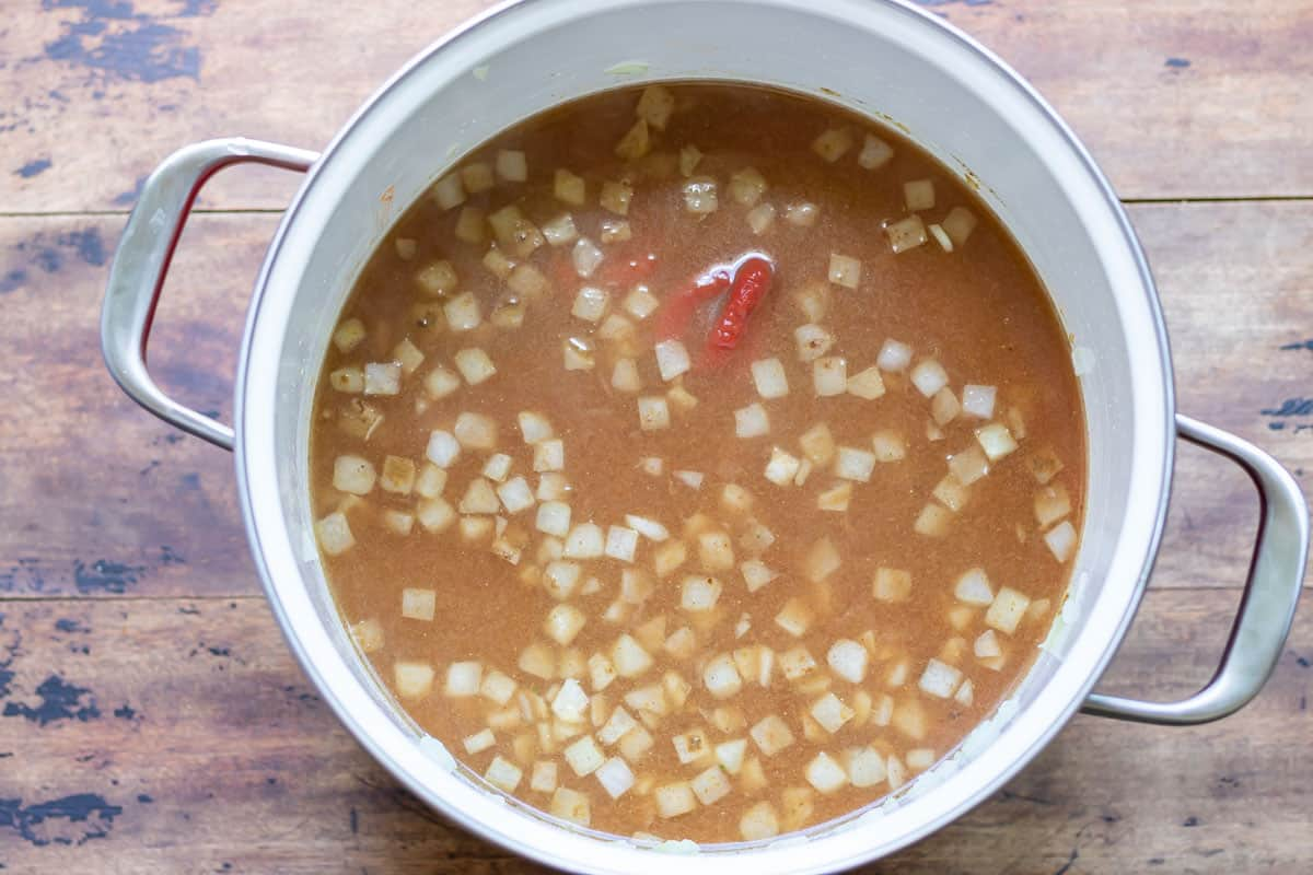 Chickpeas, stock and tomatoes added.