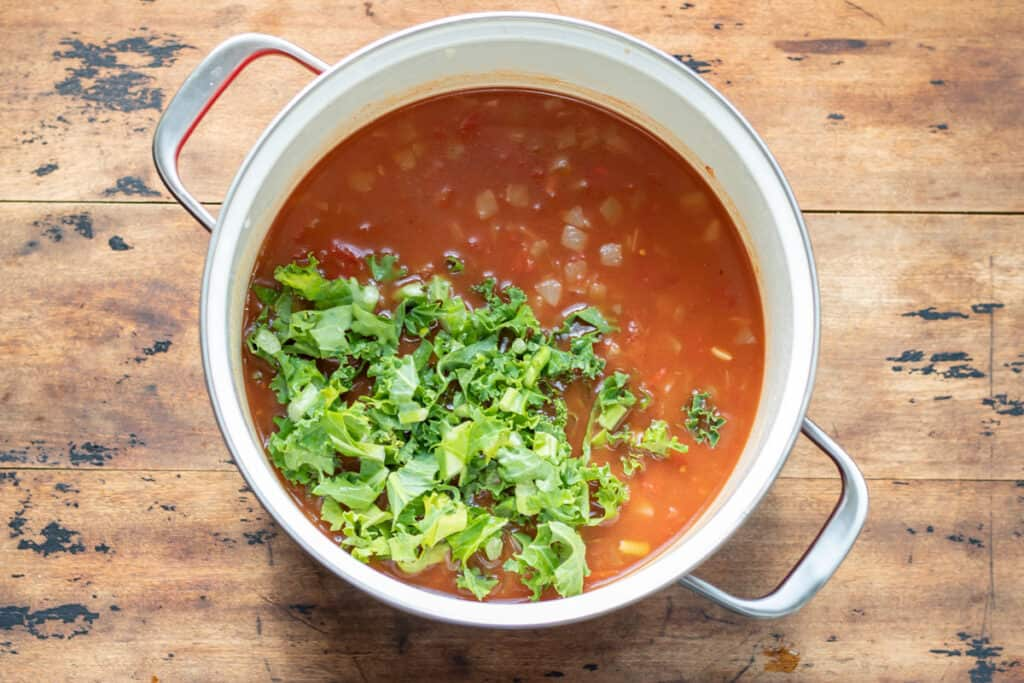 Kale added to the soup.