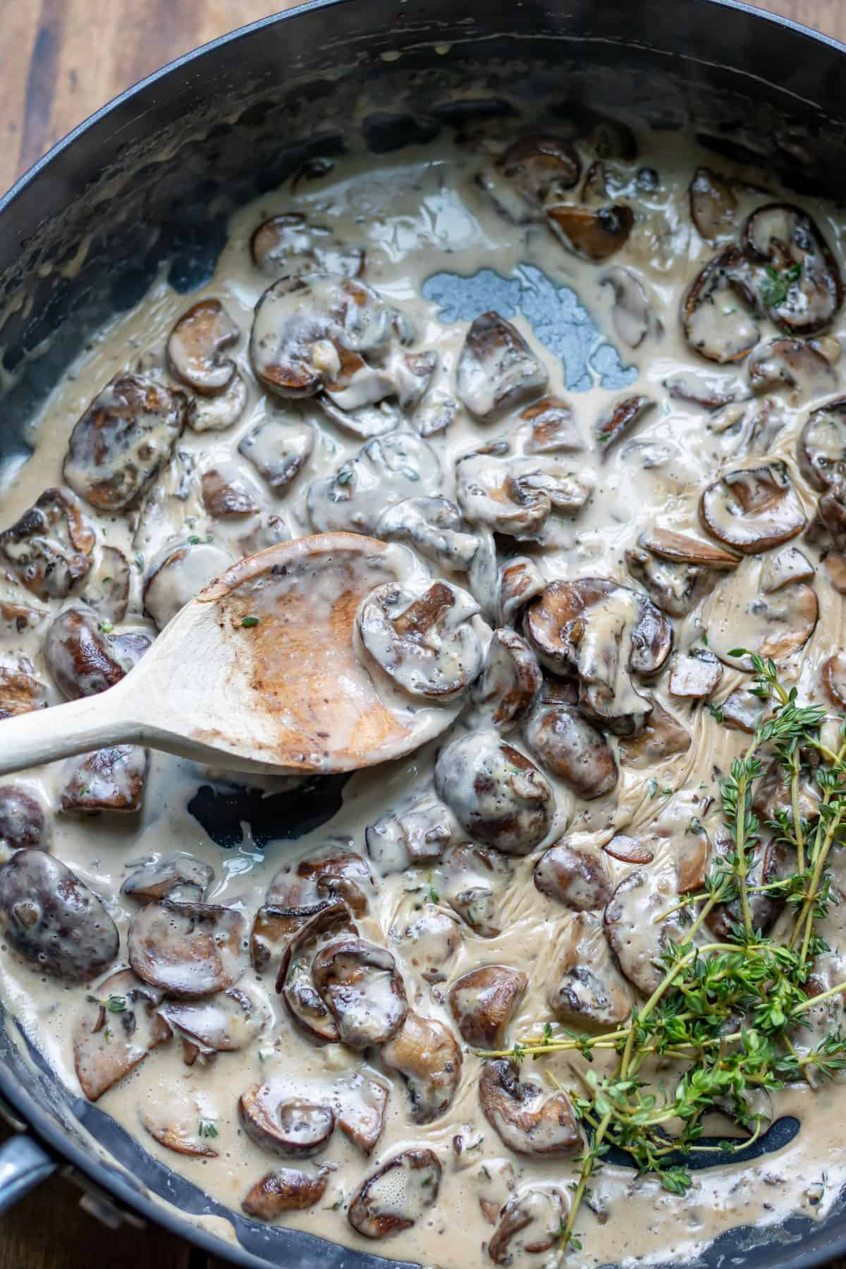Spoon in a pan of creamy mushrooms.