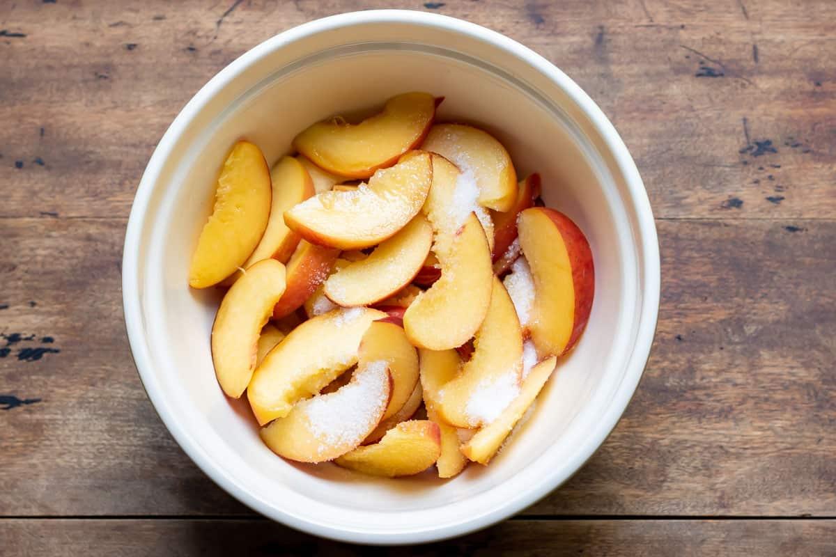 Bowl of sugared peaches.