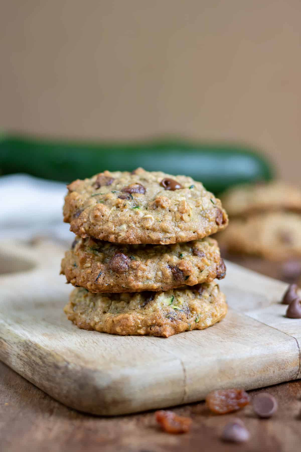 Stack of cookies on a wooden board.