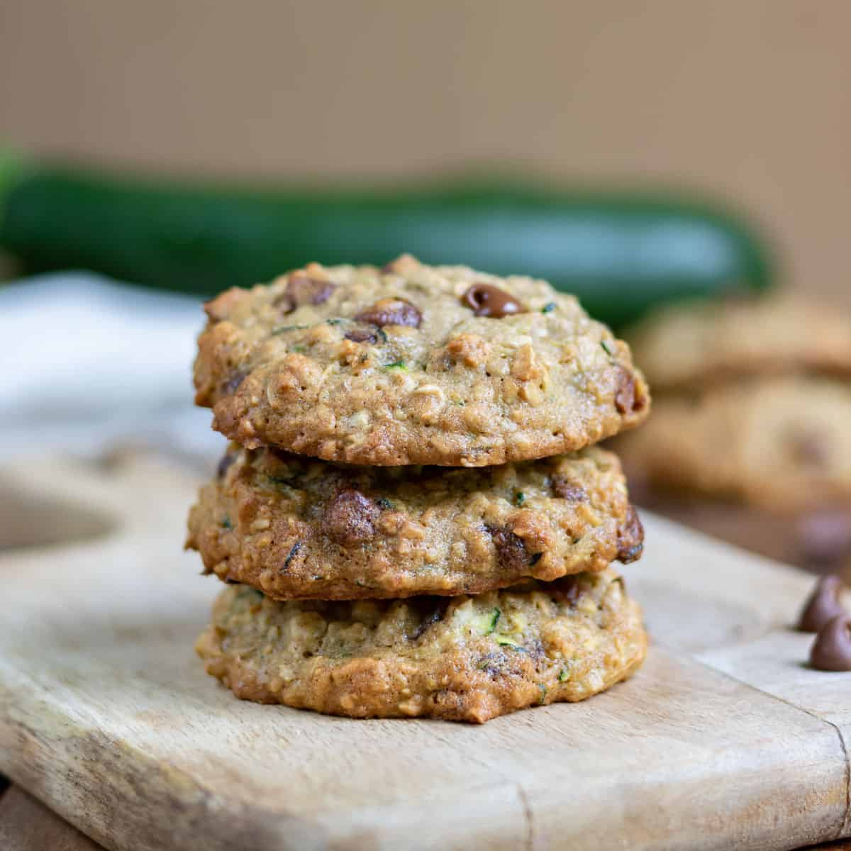 Stack of cookies on a cutting board.