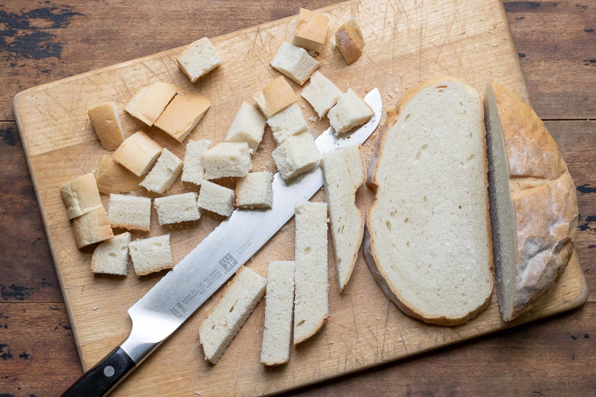 Cutting bread into cubes.