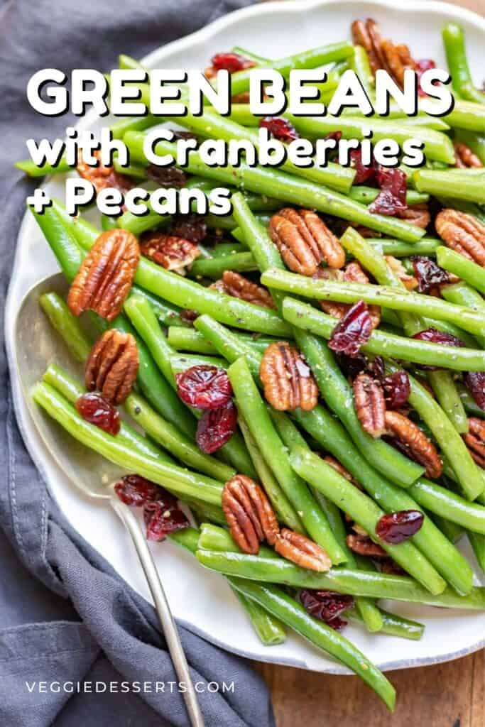 A plate of beans with text: Green Beans with Cranberries and Pecans