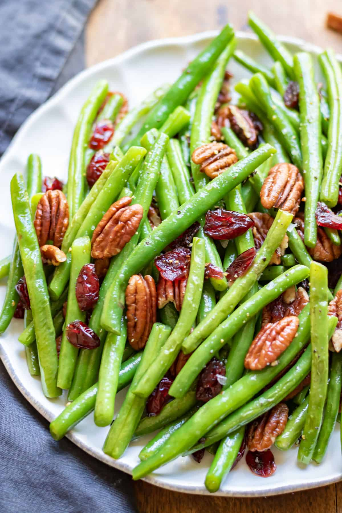 Close up of green beans sauteed with cranberries and pecans.