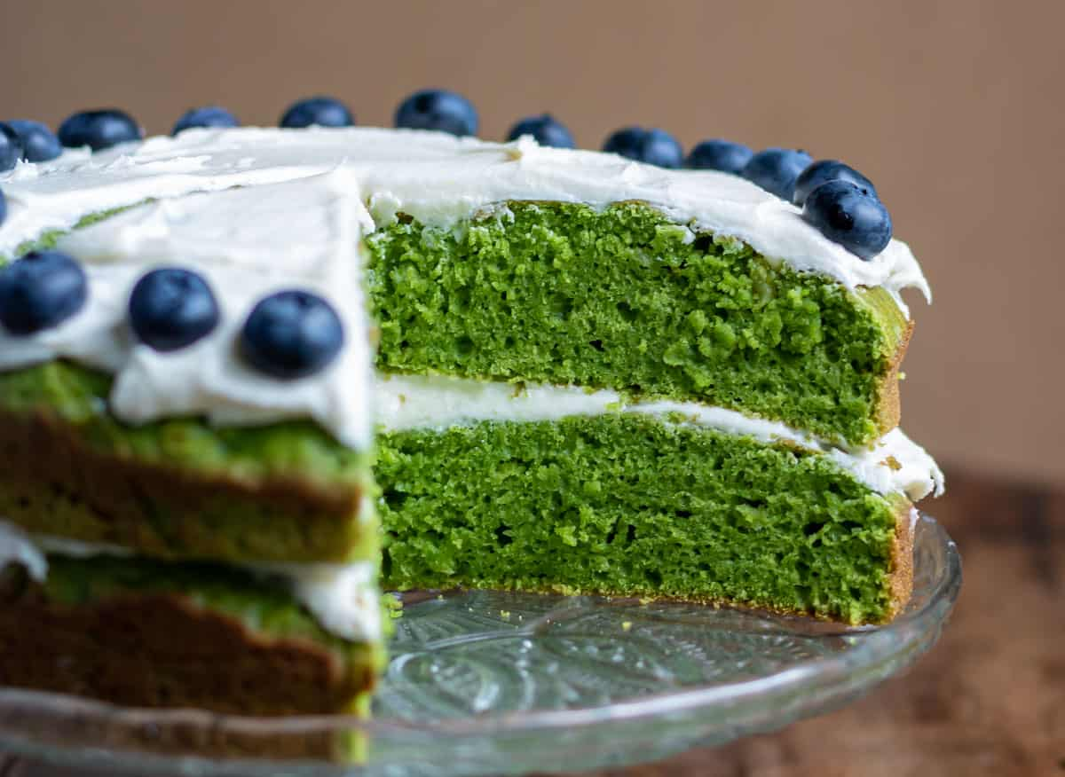 Close up of a cake with a slice out.