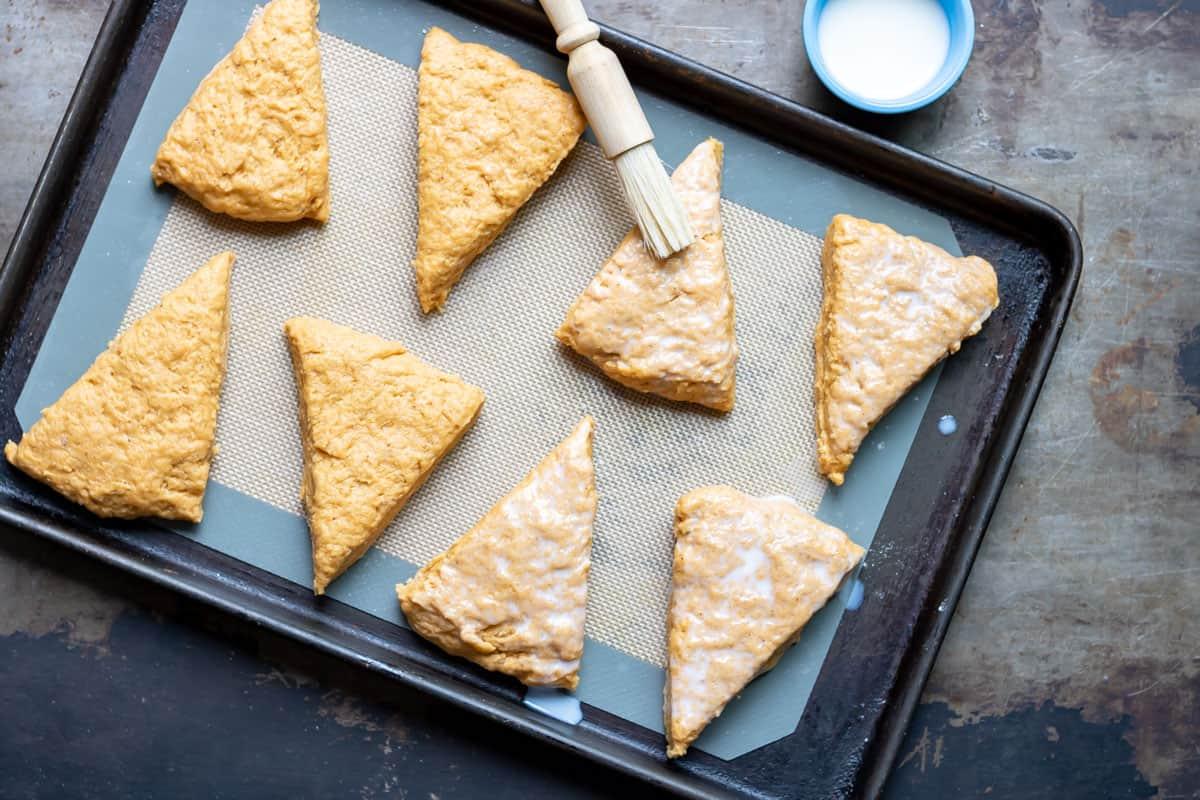 Brushing scones with milk.