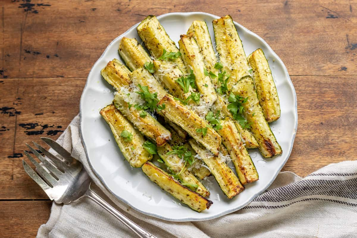 Serving dish of roasted zucchini with parmesan cheese.