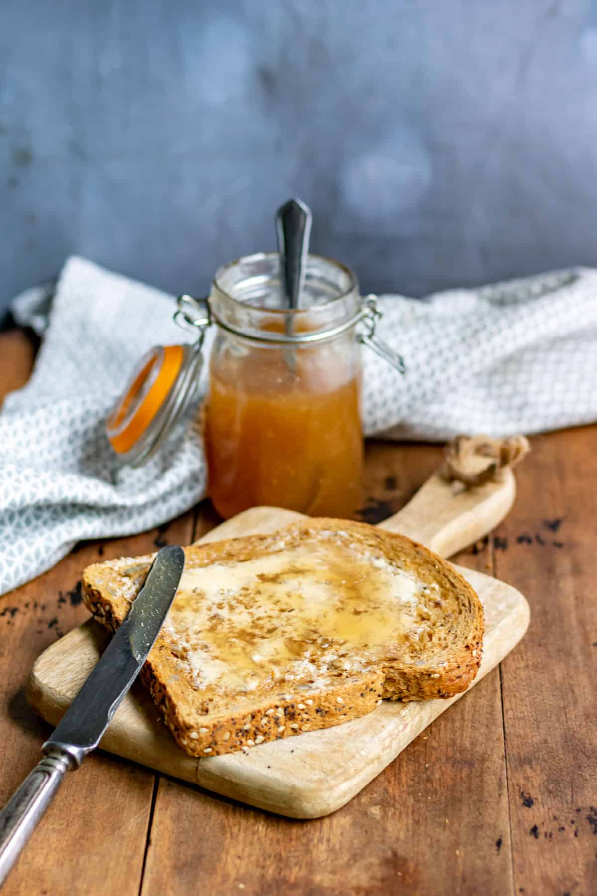 Table with toast spread with vegan honey.