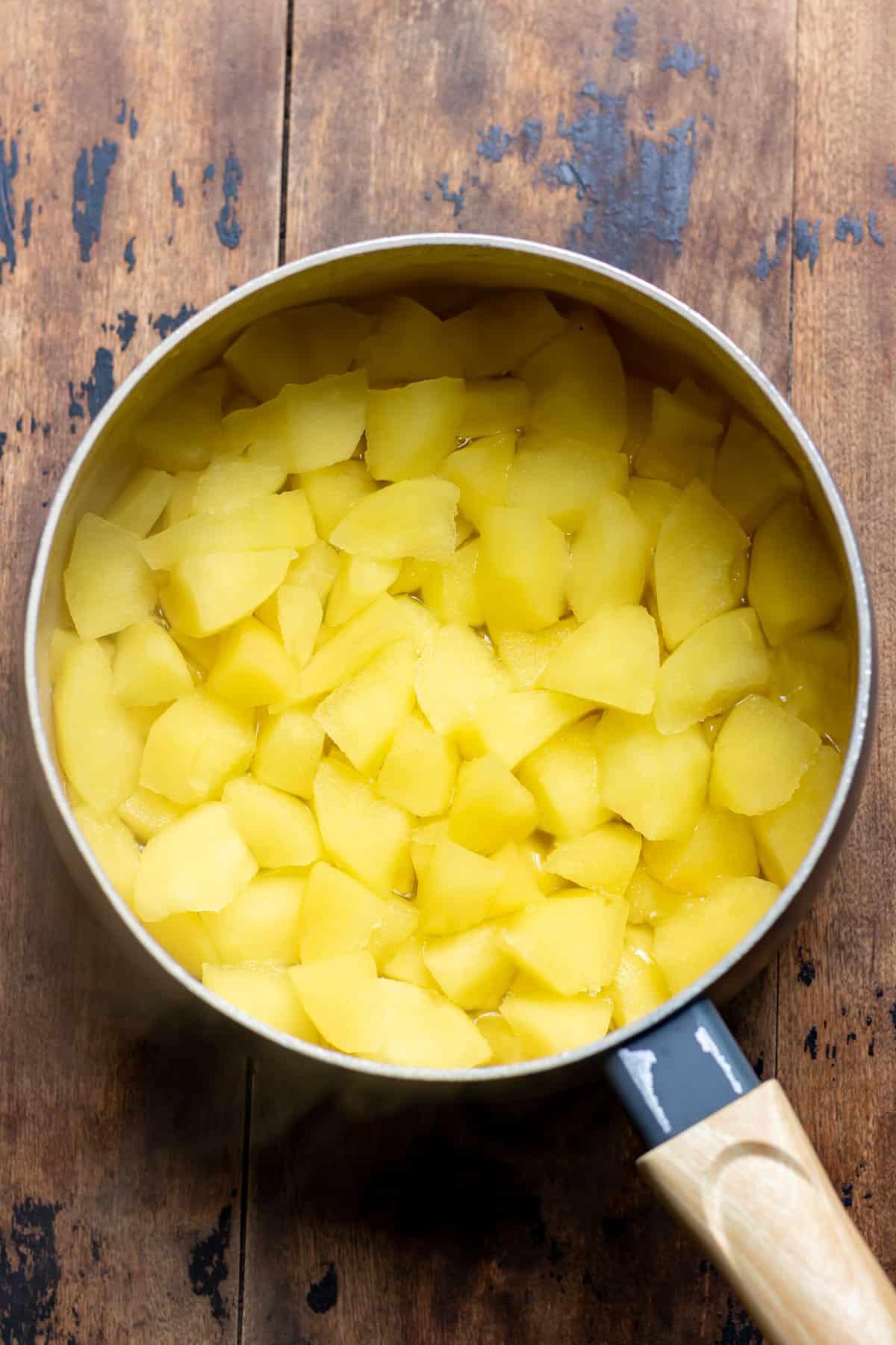 Cooking applesauce.