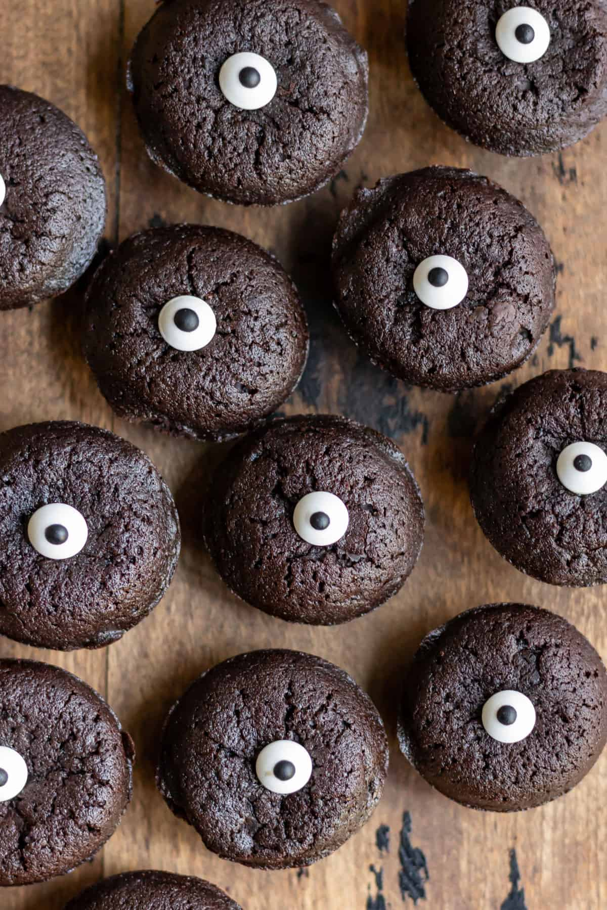 Rows of candy eye-topped brownie bites.
